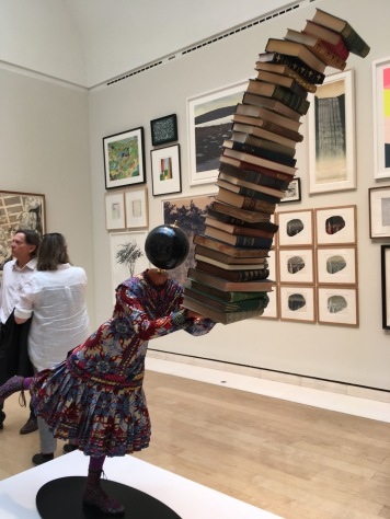 Yinka Shonibare RA Young Academician fibreglass mannequin, Dutch wax printed textile, books, globe and steel baseplate